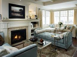 living room design with stone fireplace front door laundry