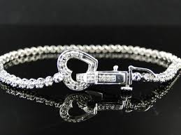 diamond bracelet women images White gold finish genuine diamond womens heart tennis bracelet jpg