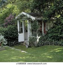 Summer House In Garden - stock images of small lawn in front of white summerhouse in