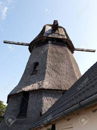 old traditional country windmill in funen denmark stock photo