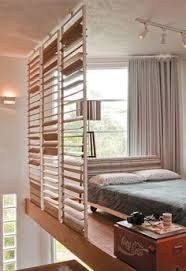 Wall Room Divider by 15 Creative Ideas For Room Dividers A Wood Panel Wall Separates
