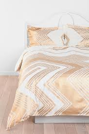 tan and white urban outfitters bedspreads with chevron bedding