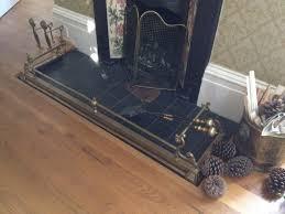 antique brass fire fender adjustable width in dorking surrey