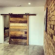 barn door cafe grand minimalist interior design with grey wall also reclaimed