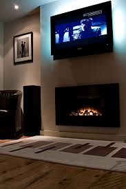hanging flat panel hdtvs over the fireplace both professional installers and ergonomic specialists have long