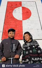 Painting A Flag Two Local Boys In Front Of A Large Painting Of The Greenland Flag
