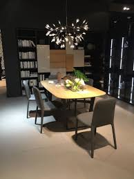 a trip into the world of stylish dining tables beautiful dining table with lighting fixture above