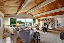 old fashion living room with vaulted wood plank ceiling walkout