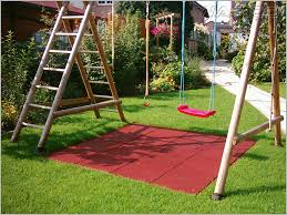 Backyard Swing Set Ideas by How To Landscape Under A Swing Set Helpfulhowtos