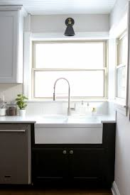 white kitchen cabinets with farm sink what to consider when choosing a farmhouse sink the diy