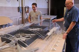 museum staff prepares aircraft for display in fourth building