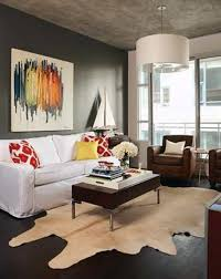 condo living room design with dark grey wall color and wall art