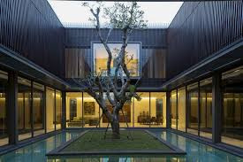 house with courtyard modern house with water surrounded courtyard in the center