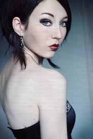 Dark Hair Light Skin Female Youth Twenties Alone Indoors Trigger Image