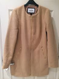a camel coat ideal for spring from good ol next i won t wear