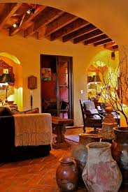 southwestern style homes with wooden table and pottery and woodern