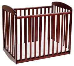 Solid Wood Mini Crib by Amazon Com Davinci Alpha Mini Rocking Crib Cherry Cradle Baby