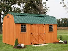 wooden cedar stained maxibarn shed with a green gambrel roof