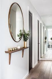 foyer mirrors chic foyer hallway features a gold oversized mirror placed