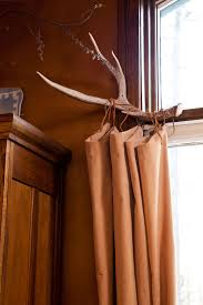 Western Curtain Rod Holders Since We Live In The Mountains I Thought A Deer Horn Curtain Rod