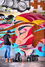 mural artist painting in graffiti garage in tacoma washington mural artist painting in graffiti garage in tacoma washington