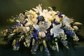 blue casket spray jephry floral studio