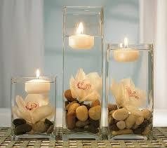 composizione di candele centrotavola fai da te con sassi e candele bellissimi
