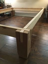 walnut and cedar notched timber bed frame and headboard
