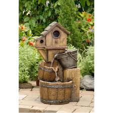 this distressed bird house fountain will add a rustic style to