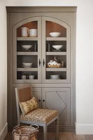 gray kitchen cabinets with chicken wire doors transitional kitchen