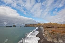 beaches with black sand black sand beach with lundadrangur rock arch in dyrholaey south
