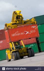 cvs ferrari 378 reach stacker lifting a large shipping container