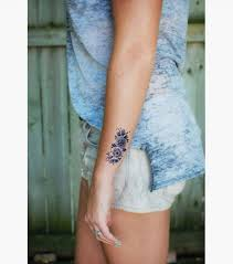 the 25 best flower wrist tattoos ideas on pinterest lotus