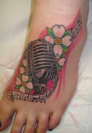 microphone and flower tattoo designs for on foot flowers
