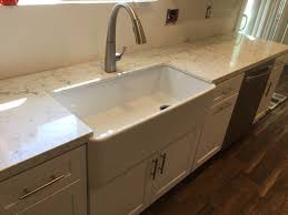 white shaker full overlay kitchen cabinets with quartz carrara