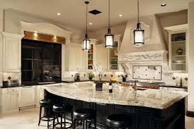 open plan kitchen with white cabinets and traditional style fine