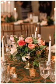 Feather And Flower Centerpieces by Wedding Reception Tabletop With Gorgeous Gold And Green Damask