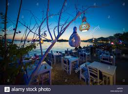 Hanging Tree Lights by Informal Beachside Seating With Decorative Gourd Lights Hanging