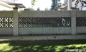 Brick fence with decorative concrete blocks picture