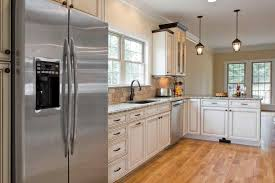 green walls and ge white kitchens with black appliances profile