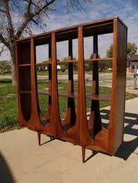 mid century modern room divider bookshelf by kent coffey want