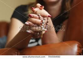 praying rosary stock photo 704594692