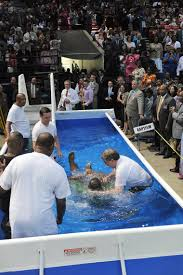 baptism pool jehovah s witnesses baptize 28 in pool at bjcc arena al