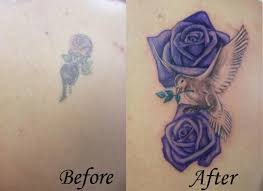 lower back cover up tattoos purple roses with dove cover up