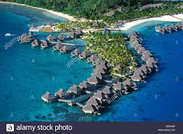 aerial photo of holiday resort with water bungalows french stock