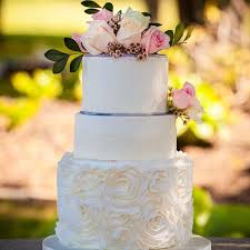 wedding cake ottawa rosettes in fondant lace and fresh roses decorate this lovely