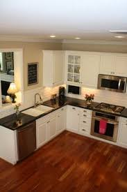 Kitchen Countertops With White Cabinets by Would Love To Have A Kitchen With An Island And Black Marble