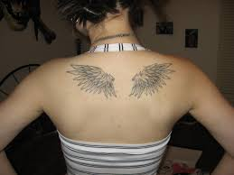 small angel wings tattoo on upper back for girls photos