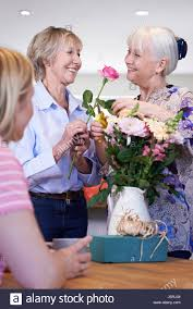women meeting at flower arranging class stock photo royalty free