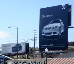 audi dealership exterior billboards war bmw vs audi
